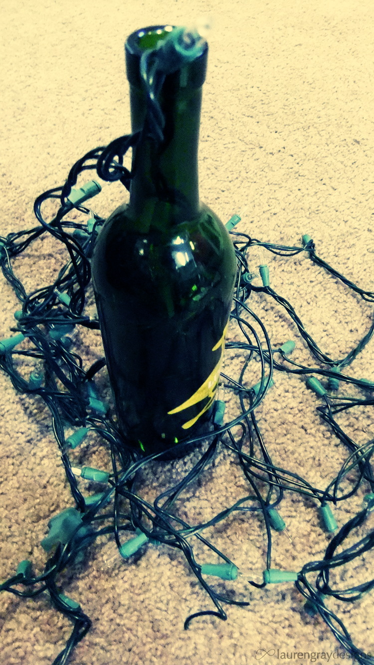Stuffing Christmas lights into a wine glass